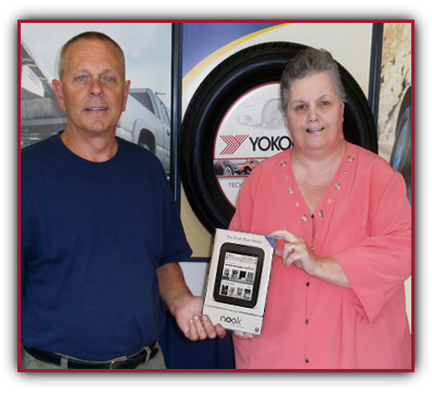 Pam Cannon receiving NOOK with Qyst's Alan C. Heim, retired US Marine Sergeant.